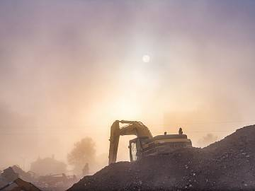 Construction equipment amid dusk and haze
