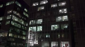 Exterior shot of office buildings at night