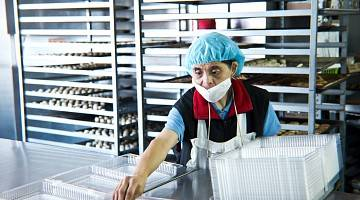 A woman with disability works in a bakery