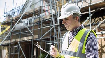 Inspector goes over checklist at construction site