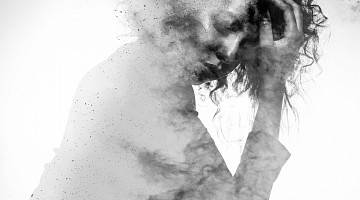 Monochrome splatter painting of a woman in distress