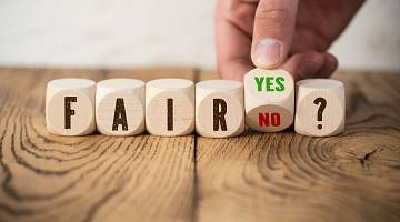 Wooden blocks spell out the words 'fair,' and 'yes or no?'
