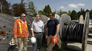 Management and workers at K-W Hydro share a chat