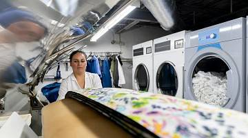 A woman works at a laundry service