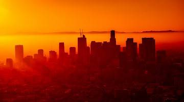 Los Angeles skyline cast in the orange glow of a sunset