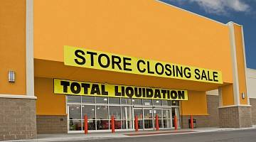 Big box store with closing sale sign