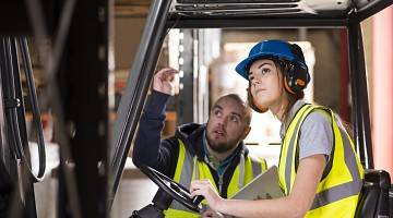 A forklift operator gets job training