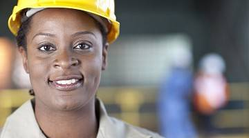 Close-up of a woman in a hard hat