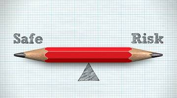 A red pencil evenly balances between Safe an Risk