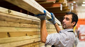 mature man working at a timber/lumber warehouse