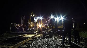 Night shift workers on railway tracks