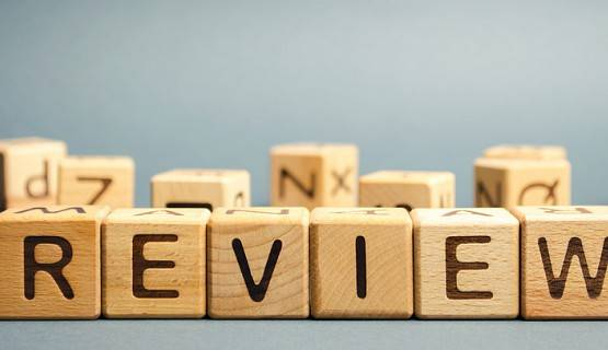 "wooden letter tiles spell out the word ""review"""